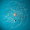 Atommodell: Um den positiv geladenen Atomkern bewegen sich die negativ geladenen Elektronen.